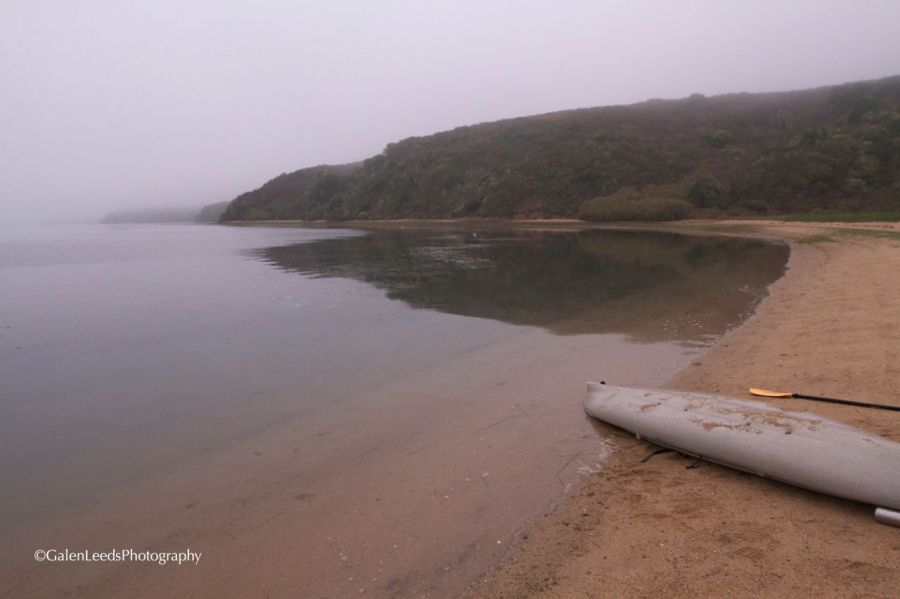 You can see the shore stretching off from my impromptu repair shop. Lots of grey foggy water, and it was finally getting lighter out